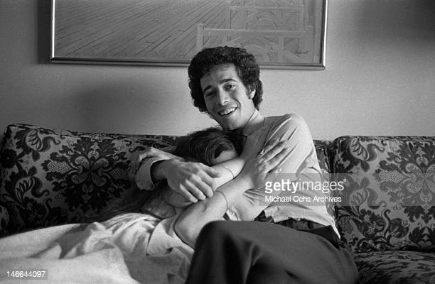 Musician Laura Nyro hides in the chest of music executive David Geffen as they pose for a portrait session on September 13 1969 in New York New York