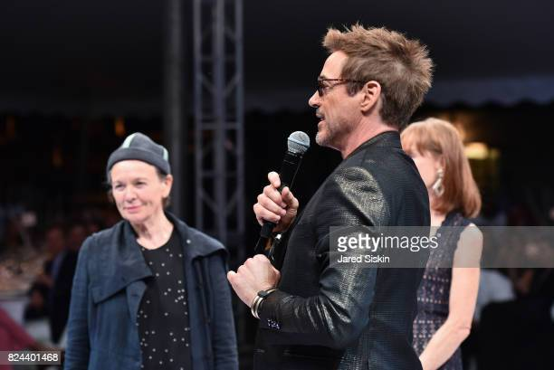 Musician Laurie Anderson actor Robert Downey Jr and Isabelle Huppert attend The 24th Annual Watermill Center Summer Benefit Auction at The Watermill...