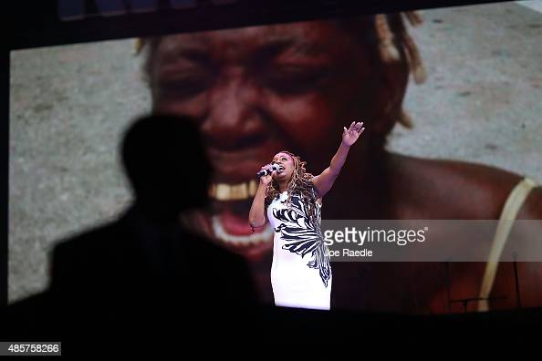 Musician Ledisi sings in front of images projected behind her of moments during Hurricane Katrina as she performs at a Hurricane Katrina 10th...