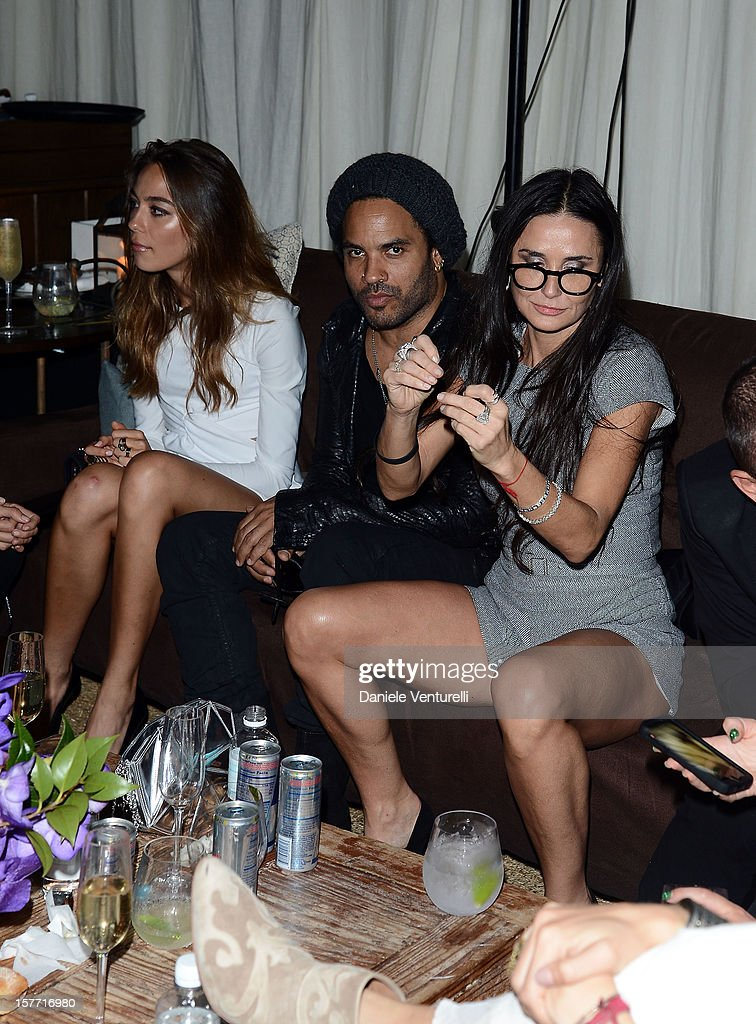 Musician Lenny Kravitz and actress Demi Moore attend Chanel beachside BBQ celebrating Art.sy at Soho Beach House on December 5, 2012 in Miami Beach, Florida.
