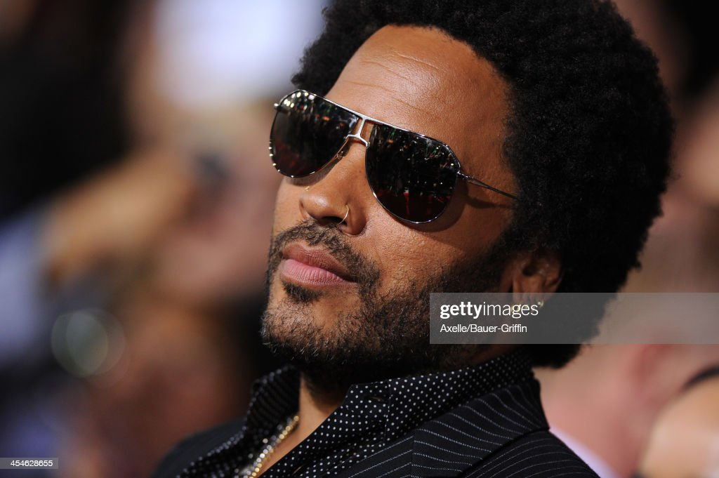 Musician <a gi-track='captionPersonalityLinkClicked' href=/galleries/search?phrase=Lenny+Kravitz&family=editorial&specificpeople=171613 ng-click='$event.stopPropagation()'>Lenny Kravitz</a> arrives at the Los Angeles Premiere of 'The Hunger Games: Catching Fire' at Nokia Theatre L.A. Live on November 18, 2013 in Los Angeles, California.