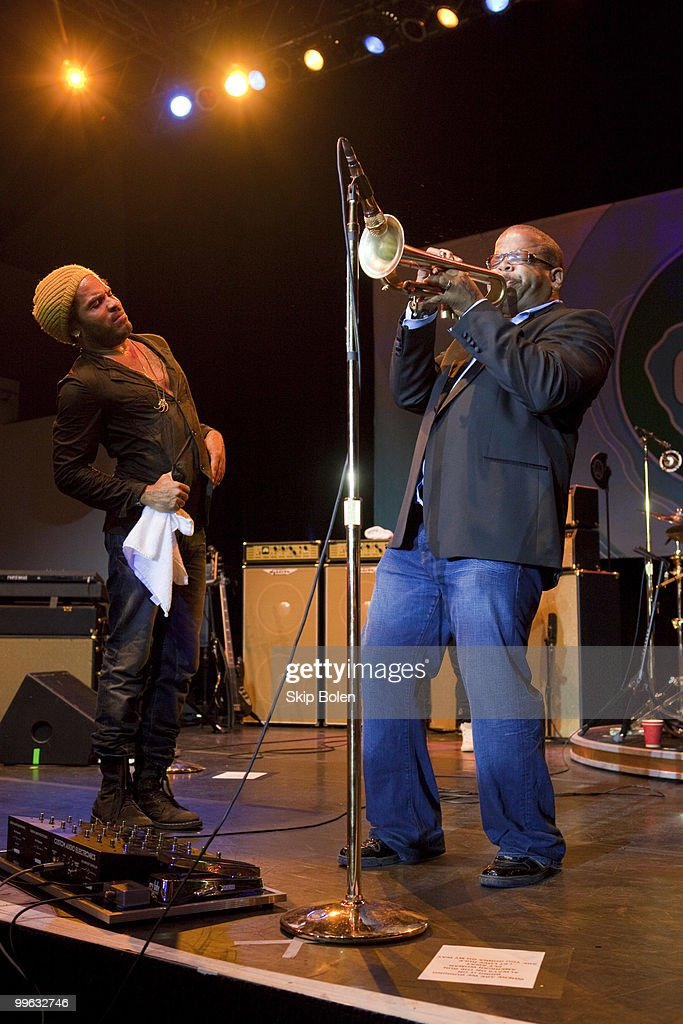 Musician Lenny Kravitz looks on as New Orleans jazz trumpeter Terence Blanchard performs at the GULF AID benefit concert at Mardi Gras World River City on May 16, 2010 in New Orleans, Louisiana.