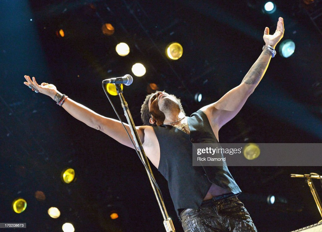 Musician <a gi-track='captionPersonalityLinkClicked' href=/galleries/search?phrase=Lenny+Kravitz&family=editorial&specificpeople=171613 ng-click='$event.stopPropagation()'>Lenny Kravitz</a> performs during the 2013 CMA Music Festival on June 8, 2013 at LP Field in Nashville, Tennessee.