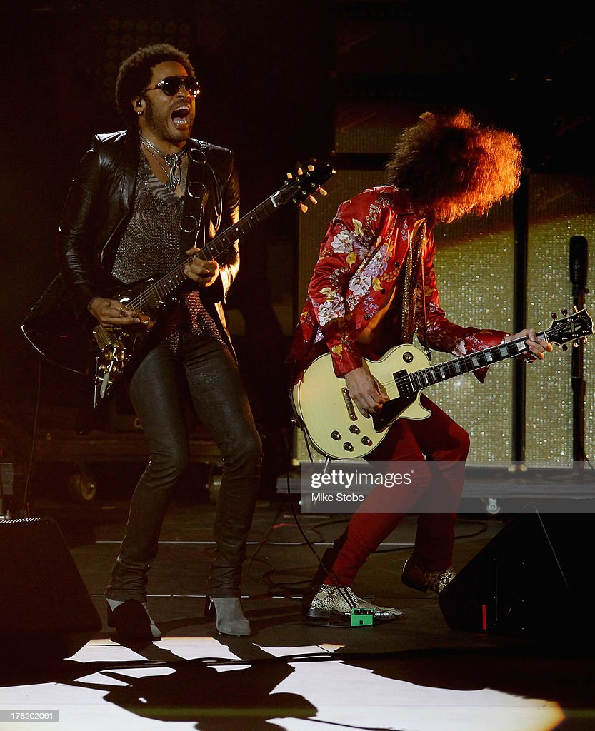 Musician <a gi-track='captionPersonalityLinkClicked' href=/galleries/search?phrase=Lenny+Kravitz&family=editorial&specificpeople=171613 ng-click='$event.stopPropagation()'>Lenny Kravitz</a> performs during the opening ceremony on Day One of the 2013 US Open at the USTA Billie Jean King National Tennis Center on August 26, 2013 in New York City.