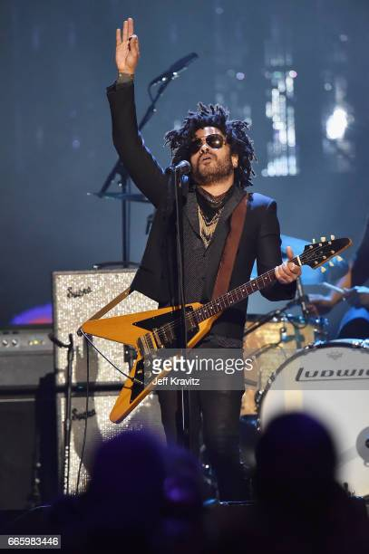 Musician Lenny Kravitz plays a tribute to 2004 inductee Prince onstage at the 32nd Annual Rock Roll Hall Of Fame Induction Ceremony at Barclays...