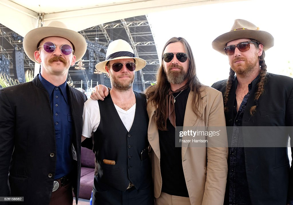 Musician Leroy Powell (C) and band members pose backstage during 2016 Stagecoach California's Country Music Festival at Empire Polo Club on April 29, 2016 in Indio, California.