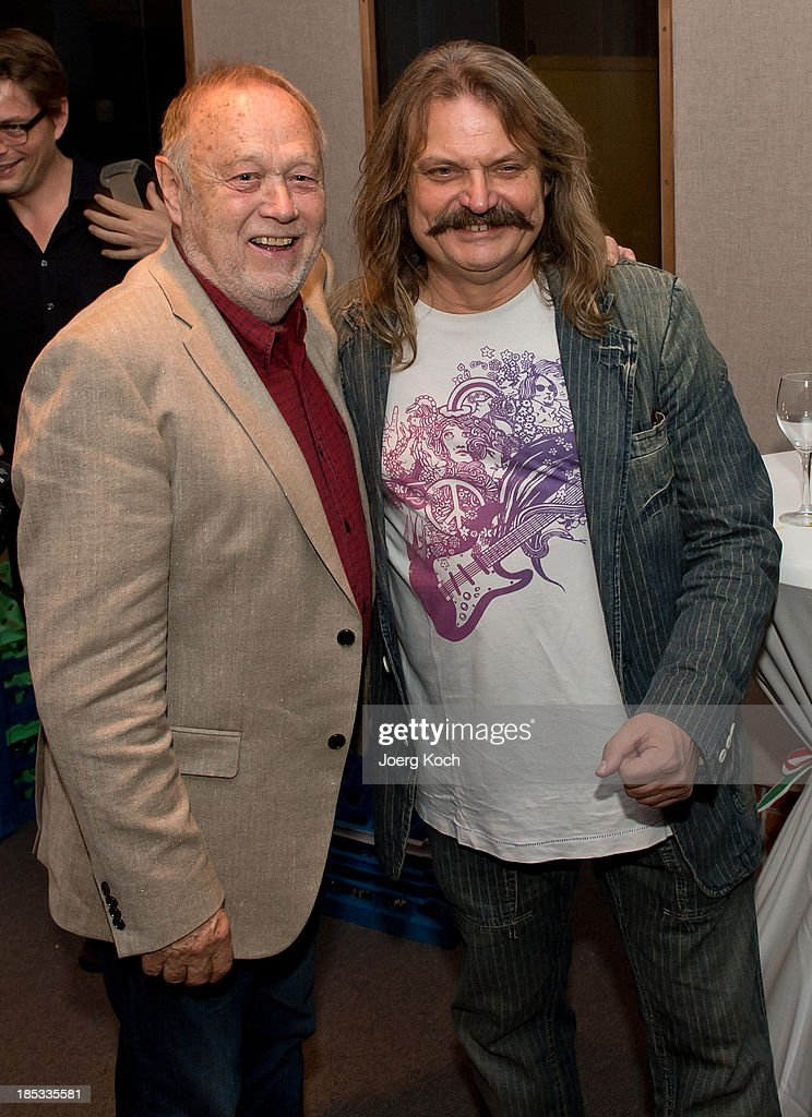 Musician Leslie Mandoki (r ) and director Joseph Vilsmaier pose during a get-together for the launch of Mandokis new Album 'BudaBest' on October 18, 2013 in the Red Rock Studios in Tutzing near Munich, Germany. Mandoki recorded the new album in Budapest featuring Jack Bruce (Cream), Bobby Kimball (Toto), Chris Thompson (former Manfred Mann`s Earth Band), John Helliwell (Supertramp) and Peter Maffay.