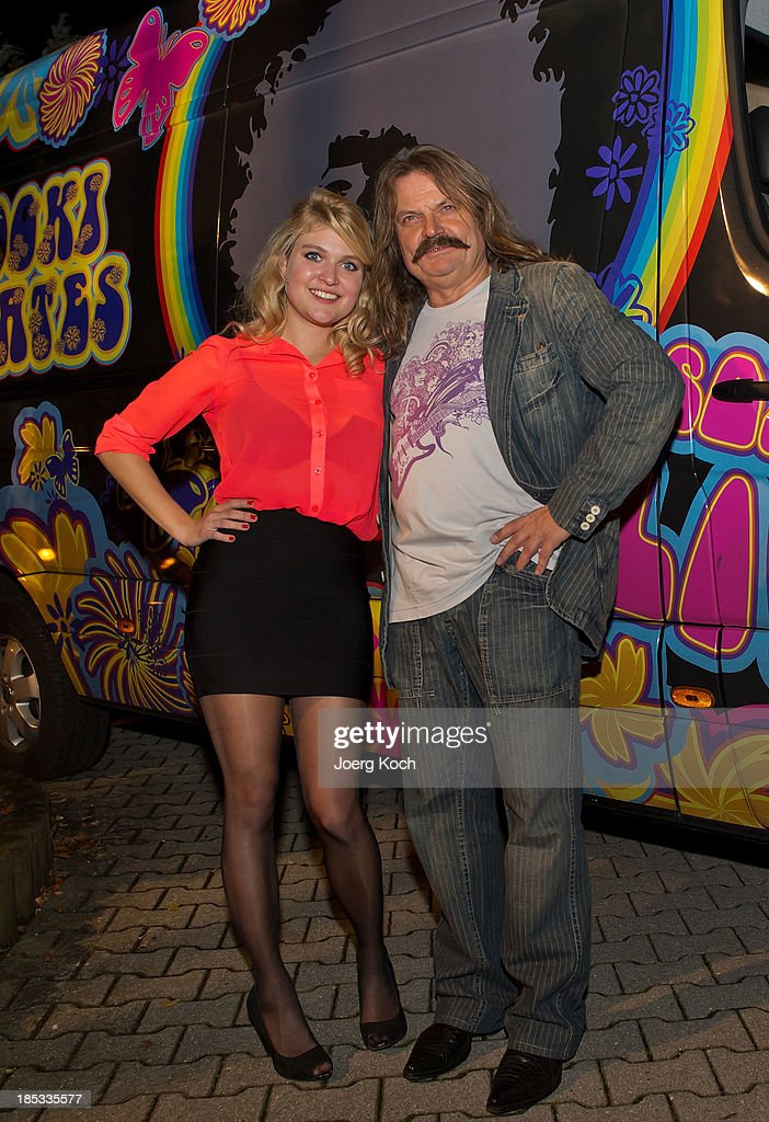 Musician Leslie Mandoki and his daughter, actress Lara Mandoki, pose in front of a colourful painted tour-bus during a get-together for the launch of Mandokis new Album 'BudaBest' on October 18, 2013 in the Red Rock Studios in Tutzing near Munich, Germany. Leslie Mandoki recorded the new album in Budapest featuring Jack Bruce (Cream), Bobby Kimball (Toto), Chris Thompson (former Manfred Mann`s Earth Band), John Helliwell (Supertramp) and Peter Maffay.