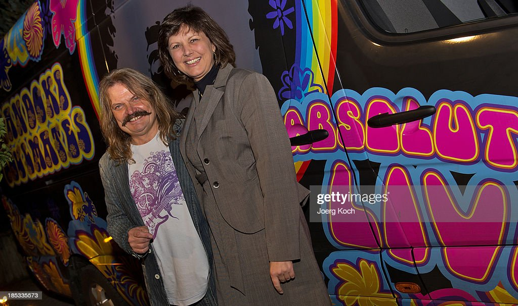 Musician Leslie Mandoki and the bavarian minister for economic affairs, Ilse Aigner (CSU), pose in front of a colourful painted tour-bus during a get-together for the launch of Mandokis new Album 'BudaBest' on October 18, 2013 in the Red Rock Studios in Tutzing near Munich, Germany. Leslie Mandoki recorded the new album in Budapest featuring Jack Bruce (Cream), Bobby Kimball (Toto), Chris Thompson (former Manfred Mann`s Earth Band), John Helliwell (Supertramp) and Peter Maffay.