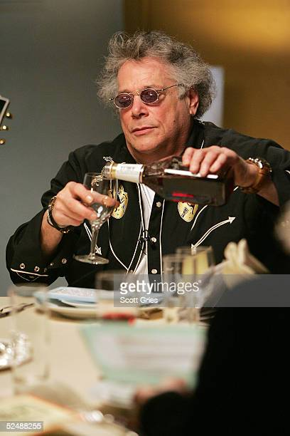Musician Leslie West of Mountain pours some wine during a taping for the VH1 Classic special 'Matzoh And Metal A Very Classic Passover' at the VH1...