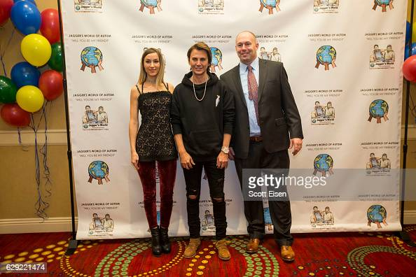 Musician Lexz Pryde left with Jonathan Cheban center with Dennis Vanasse author cofounder and vice president of The Foundation for Autism Acceptance...