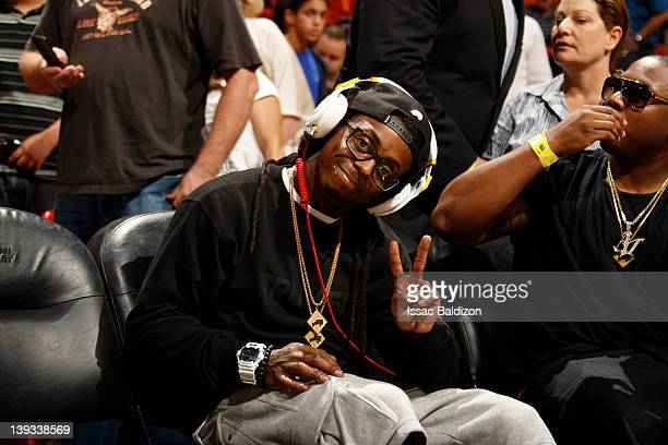 Musician Lil Wayne poses for a photo during the game between the Orlando Magic and Miami Heat on February 19 2012 at American Airlines Arena in Miami...
