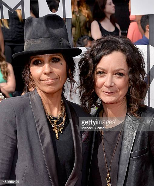 Musician Linda Perry and actress Sara Gilbert attend the 2014 MTV Movie Awards at Nokia Theatre LA Live on April 13 2014 in Los Angeles California