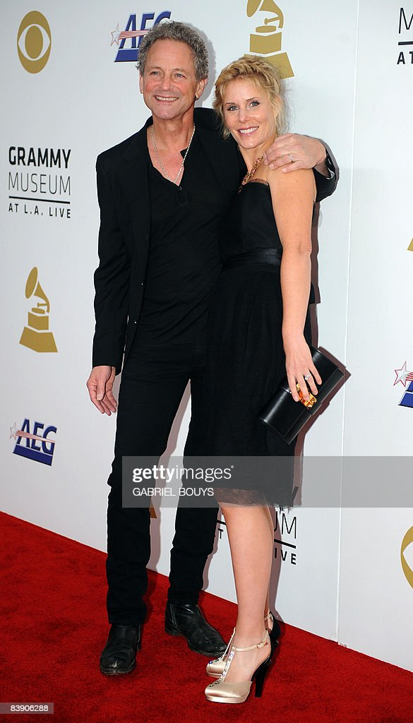 Musician Lindsey Buckingham of Fleetwood Mac arrives with his wife Kristen Buckingham at the Nokia Theater in downtown Los Angeles, December 3, 2008, to attend the announcement of nominations for the 51st Annual Grammy Awards.