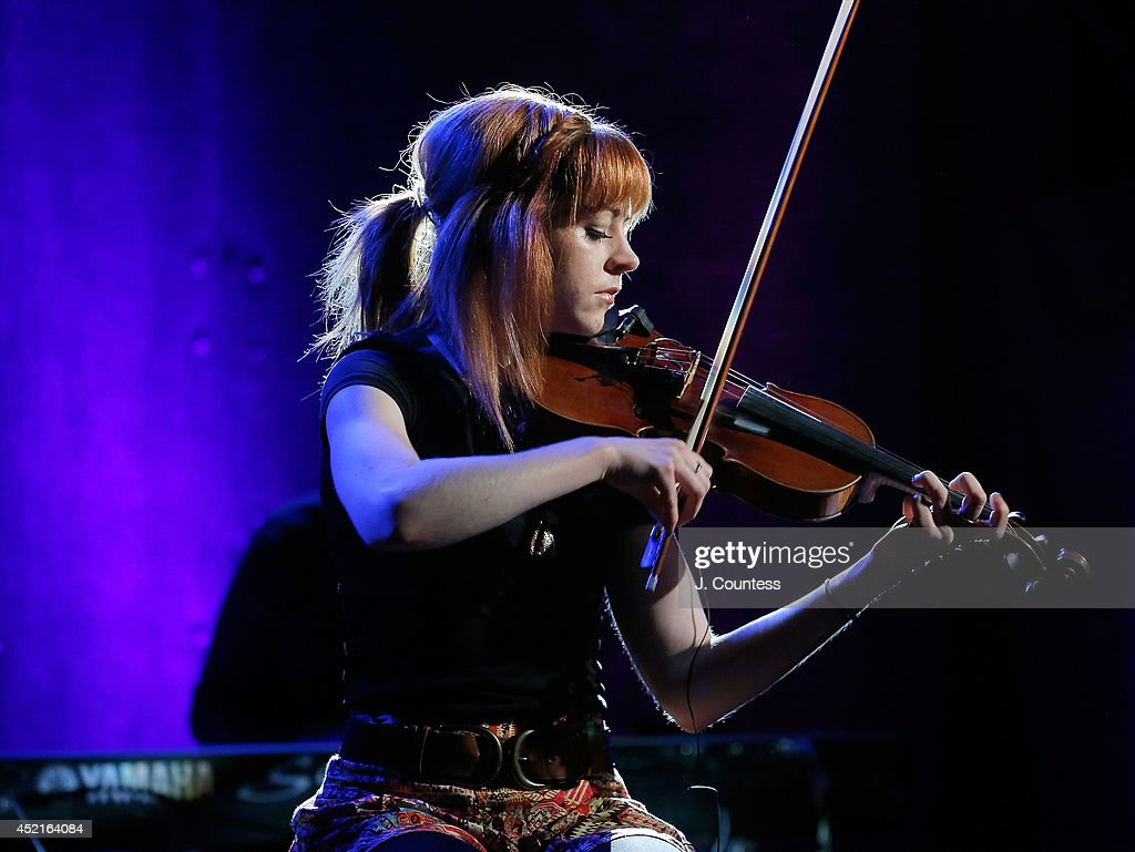 Musician <a gi-track='captionPersonalityLinkClicked' href=/galleries/search?phrase=Lindsey+Stirling&family=editorial&specificpeople=9719845 ng-click='$event.stopPropagation()'>Lindsey Stirling</a> performs during the AOL Build Speakers Series at AOL Studios on July 14, 2014 in New York, United States.