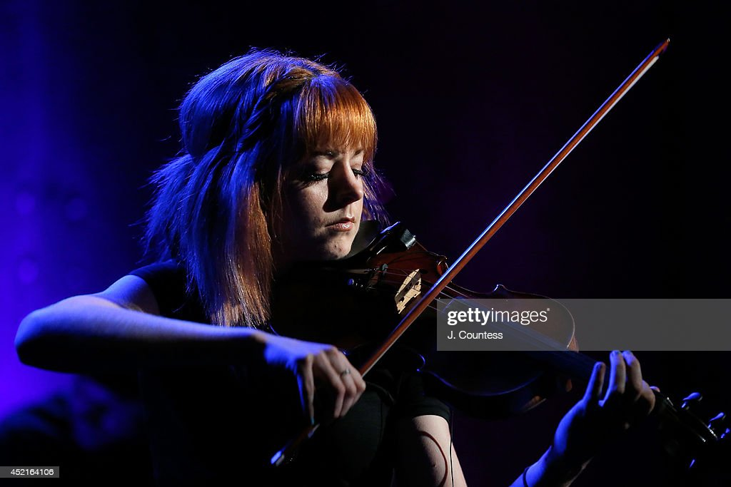 Musician Lindsey Stirling performs during the AOL Build Speakers Series at AOL Studios on July 14, 2014 in New York, United States.