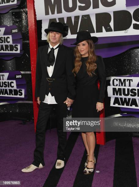 Musician Lisa Marie Presley and Michael Lockwood attend the 2013 CMT Music awards at the Bridgestone Arena on June 5 2013 in Nashville Tennessee