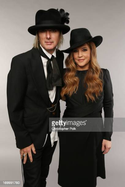 Musician Lisa Marie Presley and Michael Lockwood pose at the Wonderwall portrait studio during the 2013 CMT Music Awards at Bridgestone Arena on June...