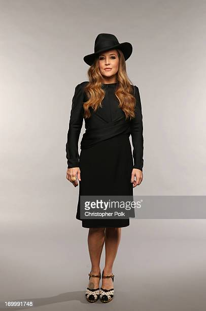 Musician Lisa Marie Presley poses at the Wonderwall portrait studio during the 2013 CMT Music Awards at Bridgestone Arena on June 5 2013 in Nashville...
