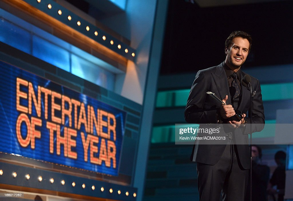 Musician <a gi-track='captionPersonalityLinkClicked' href=/galleries/search?phrase=Luke+Bryan&family=editorial&specificpeople=4001956 ng-click='$event.stopPropagation()'>Luke Bryan</a> accepts the award for Entertainer of the Year onstage during the 48th Annual Academy of Country Music Awards at the MGM Grand Garden Arena on April 7, 2013 in Las Vegas, Nevada.