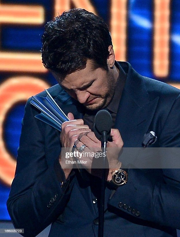 Musician <a gi-track='captionPersonalityLinkClicked' href=/galleries/search?phrase=Luke+Bryan&family=editorial&specificpeople=4001956 ng-click='$event.stopPropagation()'>Luke Bryan</a> accepts the Entertainer of the Year award onstage during the 48th Annual Academy of Country Music Awards at the MGM Grand Garden Arena on April 7, 2013 in Las Vegas, Nevada.