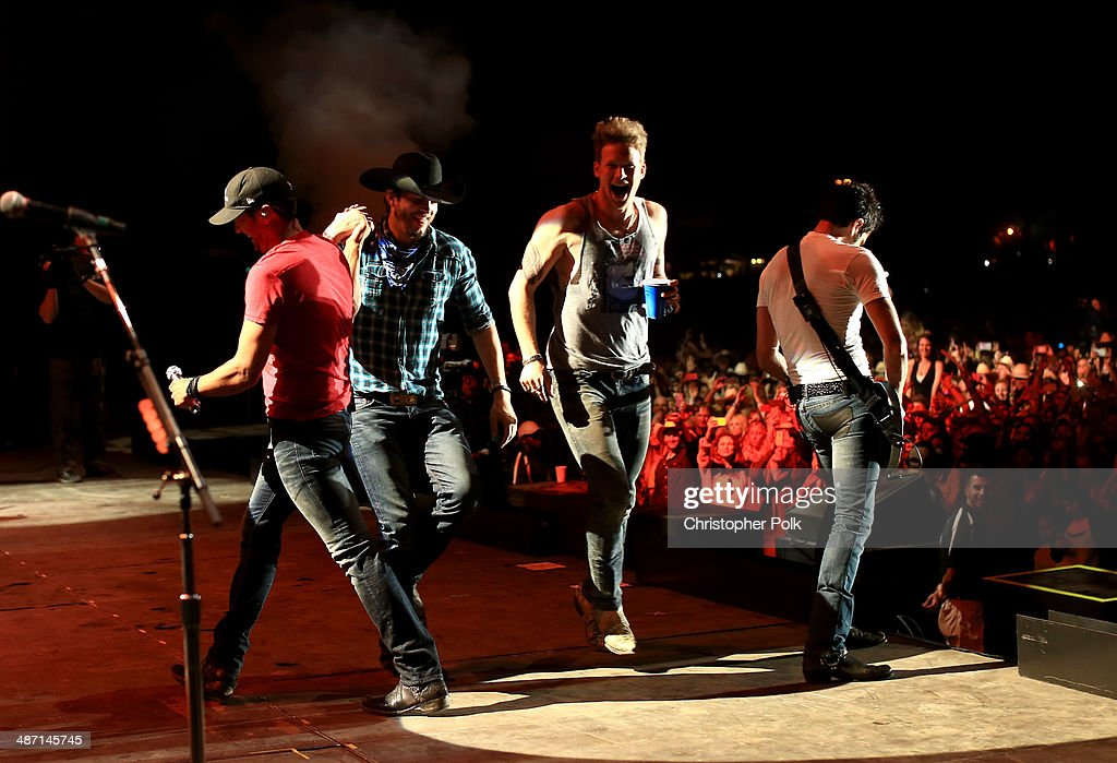 Musician Luke Bryan, actor Ashton Kutcher and musician Brian Kelley onstage during day 3 of 2014 Stagecoach: California's Country Music Festival at the Empire Polo Club on April 27, 2014 in Indio, California.