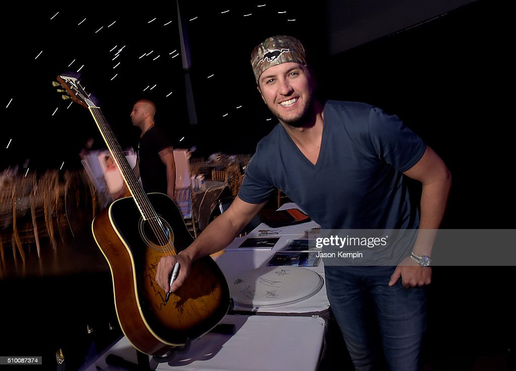 Musician <a gi-track='captionPersonalityLinkClicked' href=/galleries/search?phrase=Luke+Bryan&family=editorial&specificpeople=4001956 ng-click='$event.stopPropagation()'>Luke Bryan</a> attends the charities signings during the 2016 MusiCares Person Of The Year honoring Lionel Richie at Los Angeles Convention Center on February 13, 2016 in Los Angeles City.