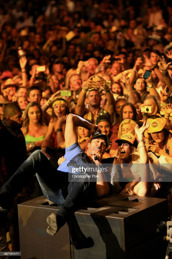 Musician Luke Bryan takes a selfie onstage during day 3 of 2014 Stagecoach: California's Country Music Festival at the Empire Polo Club on April 27, 2014 in Indio, California.
