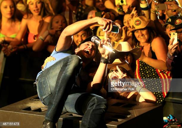 Musician Luke Bryan takes a selfie onstage during day 3 of 2014 Stagecoach California's Country Music Festival at the Empire Polo Club on April 27...