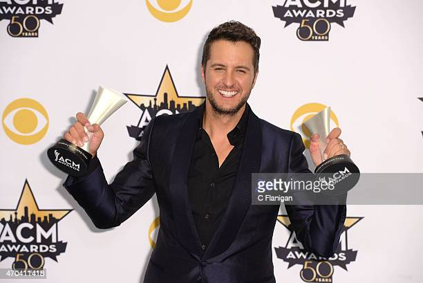 Musician Luke Bryan winner of the Entertainer of the Year Award and Vocal Event of the Year Award for 'This Is How We Roll' poses in the press room...