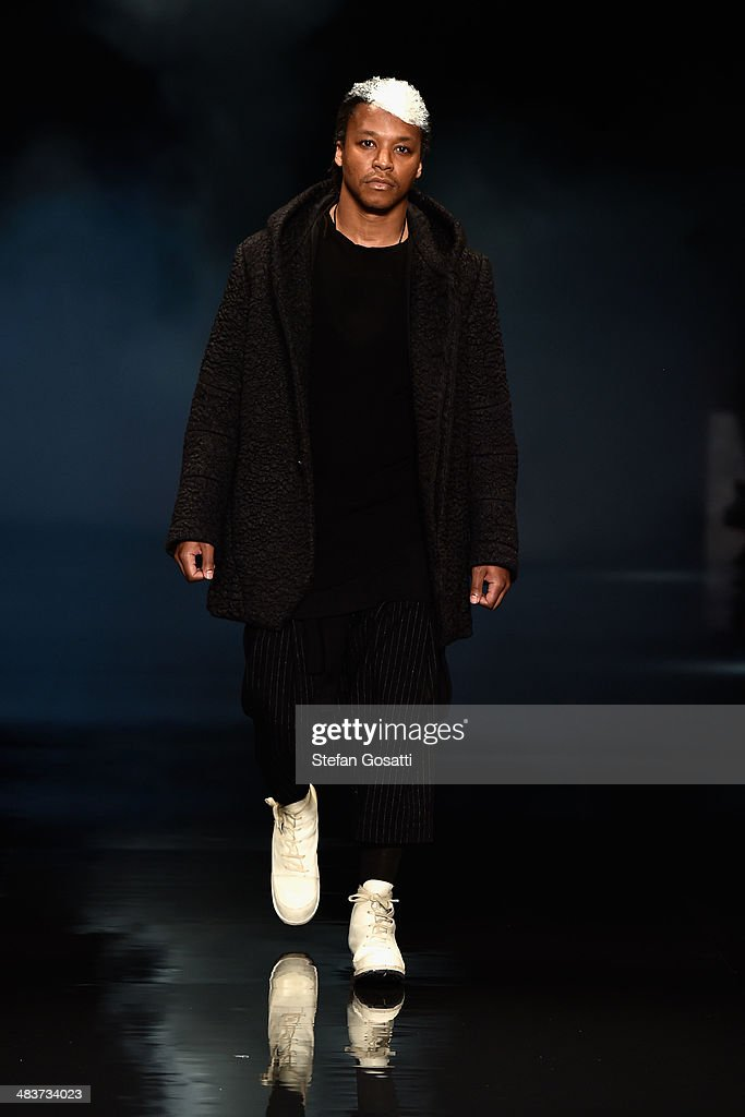 Musician <a gi-track='captionPersonalityLinkClicked' href=/galleries/search?phrase=Lupe+Fiasco&family=editorial&specificpeople=540344 ng-click='$event.stopPropagation()'>Lupe Fiasco</a> walks the runway at the Song For The Mute show during Mercedes-Benz Fashion Week Australia 2014 at Carriageworks on April 10, 2014 in Sydney, Australia.