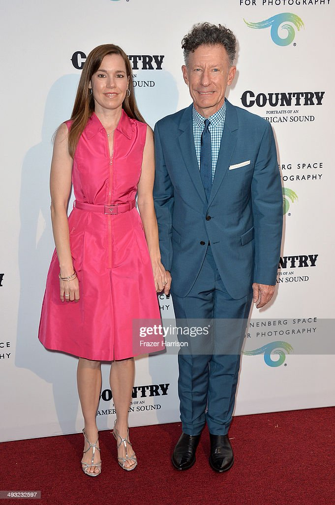 Musician Lyle Lovett (R) and April Kimble attend the Annenberg Space for Photography Opening Celebration for 'Country, Portraits of an American Sound' at the Annenberg Space for Photography on May 22, 2014 in Century City, California.