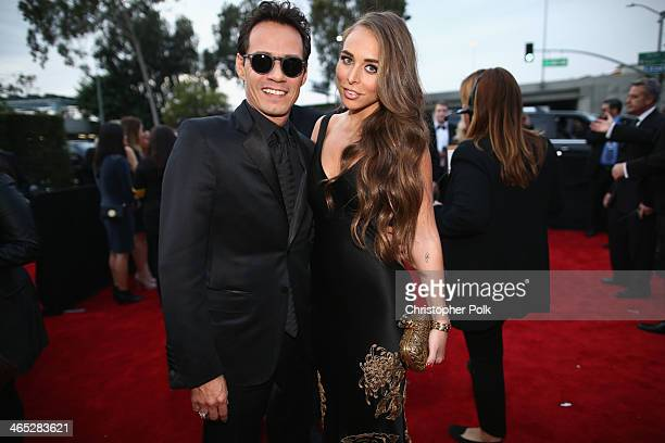 Musician Marc Anthony and TV personality Chloe Green attend the 56th GRAMMY Awards at Staples Center on January 26 2014 in Los Angeles California