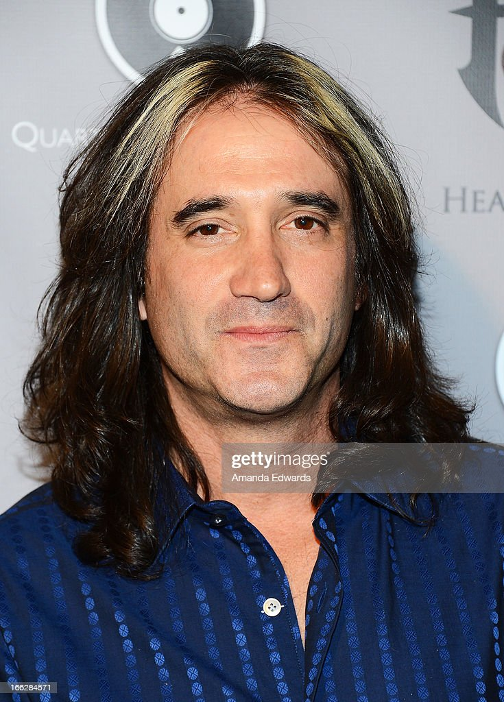 Musician Marc Ferrari arrives at the Heaven and Earth 'Dig' world premiere album release party at The Fonda Theatre on April 10, 2013 in Los Angeles, California.