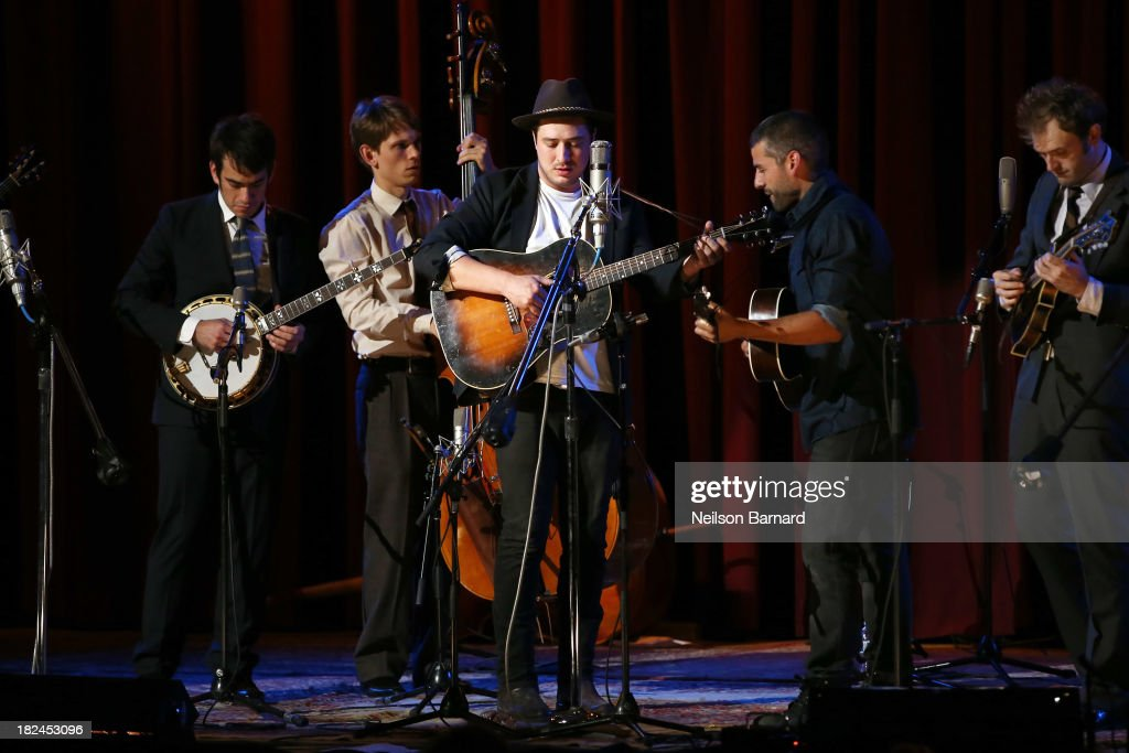 Musician Marcus Mumford performs on stage with actor Oscar Issac and the Punch Brothers during the one-night-only concert 'Another Day, Another Time: Celebrating The Music Of Inside Llewyn Davis Presented By Joel Coen, Ethan Coen and T Bone Burnett' and featuring actors Oscar Isaac, John Goodman, Carey Mulligan, Stark Sands and musicians Jack White, Patti Smith, Willie Watson, Gillian Welch, Dave Rawlings, Secret Sisters, Punch Brothers, Connor Oberst, Marcus Mumford, Colin Meloy, Lake Street Dive, Rhiannon Giddens, Joan Baez and The Avett Brothers at The Town Hall on September 29, 2013 in New York City.