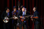 Musician Marcus Mumford performs on stage with actor Oscar Issac and the Punch Brothers during the onenightonly concert 'Another Day Another Time...