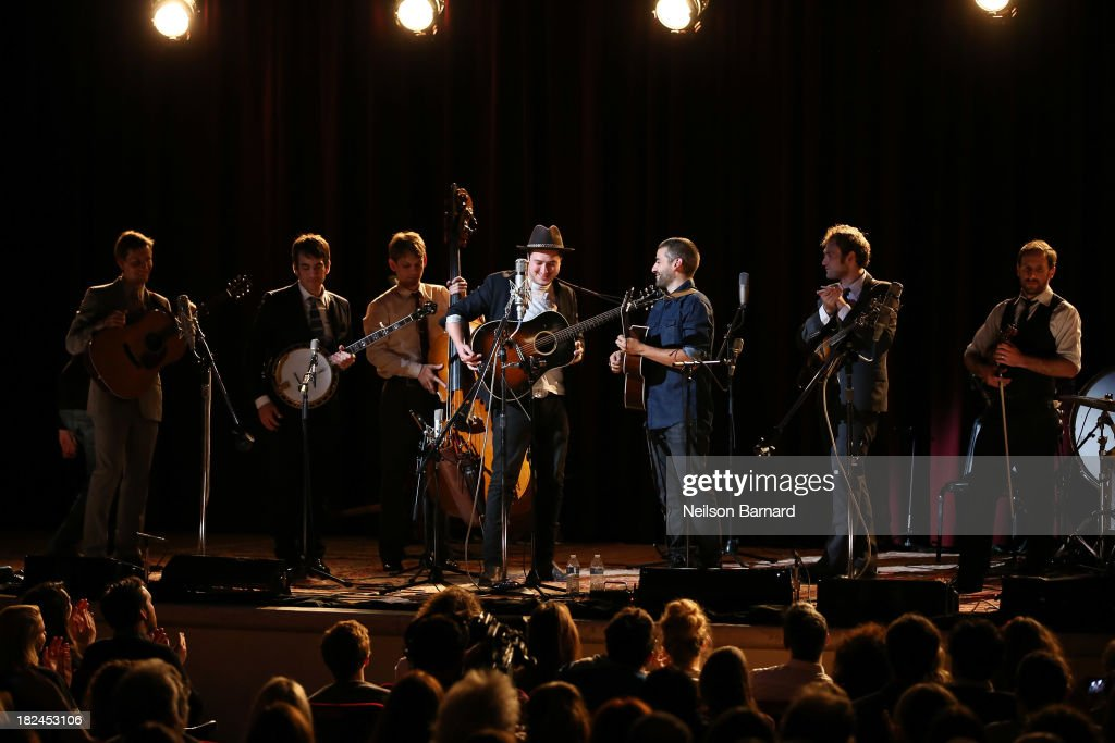 Musician <a gi-track='captionPersonalityLinkClicked' href=/galleries/search?phrase=Marcus+Mumford&family=editorial&specificpeople=5385533 ng-click='$event.stopPropagation()'>Marcus Mumford</a> performs on stage with actor Oscar Issac and the Punch Brothers during the one-night-only concert 'Another Day, Another Time: Celebrating The Music Of Inside Llewyn Davis Presented By Joel Coen, Ethan Coen and T Bone Burnett' and featuring actors Oscar Isaac, John Goodman, Carey Mulligan, Stark Sands and musicians Jack White, Patti Smith, Willie Watson, Gillian Welch, Dave Rawlings, Secret Sisters, Punch Brothers, Connor Oberst, <a gi-track='captionPersonalityLinkClicked' href=/galleries/search?phrase=Marcus+Mumford&family=editorial&specificpeople=5385533 ng-click='$event.stopPropagation()'>Marcus Mumford</a>, Colin Meloy, Lake Street Dive, Rhiannon Giddens, Joan Baez and The Avett Brothers at The Town Hall on September 29, 2013 in New York City.