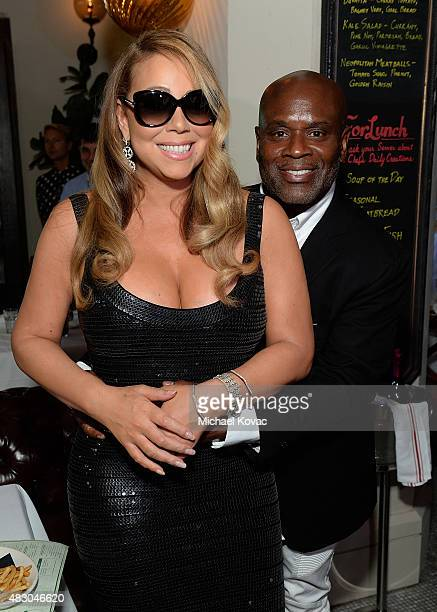 Musician Mariah Carey and producer LA Reid attend Mariah Carey Celebrates Walk Of Fame Star At Beacher's Madhouse on August 5 2015 in Los Angeles...