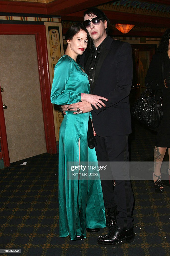 Musician <a gi-track='captionPersonalityLinkClicked' href=/galleries/search?phrase=Marilyn+Manson&family=editorial&specificpeople=208980 ng-click='$event.stopPropagation()'>Marilyn Manson</a> (R) and photographer Lindsay Usich attend the GenArt Screening Series presents 'Wrong Cops' held at the Vista Theatre on December 11, 2013 in Los Angeles, California.