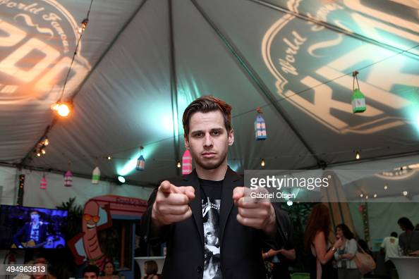 Musician Mark Foster of Foster the People poses backstage during the 22nd Annual KROQ Weenie Roast at Verizon Wireless Music Center on May 31 2014 in...