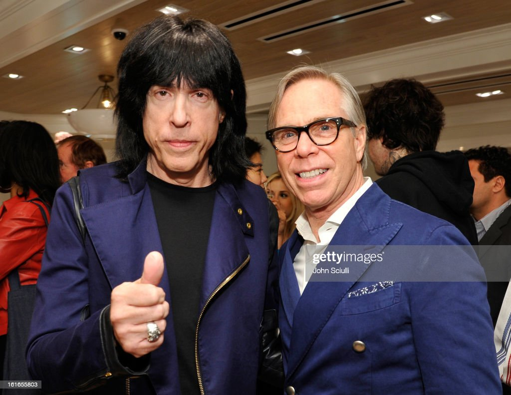 Musician <a gi-track='captionPersonalityLinkClicked' href=/galleries/search?phrase=Marky+Ramone&family=editorial&specificpeople=1995170 ng-click='$event.stopPropagation()'>Marky Ramone</a> and fashion designer Tommy Hilfiger attend Tommy Hilfiger New West Coast Flagship Opening on Robertson Boulevard on February 13, 2013 in West Hollywood, California.