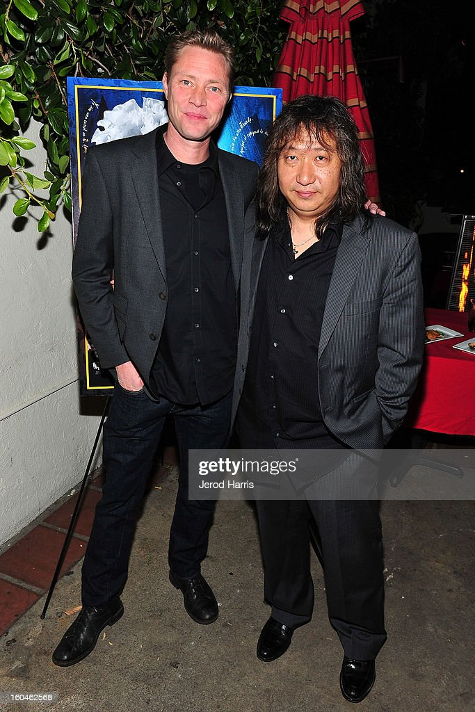Musician Martyn LeNoble and guitarist Jose Tanaka arrive at the premiere of 'Kumpania: Flemenco Los Angeles' at El Cid on January 31, 2013 in Los Angeles, California.