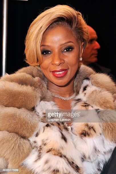 Musician Mary J Blige poses backstage at the Dennis Basso fashion show during MercedesBenz Fashion Week Fall 2014 at The Theatre at Lincoln Center on...