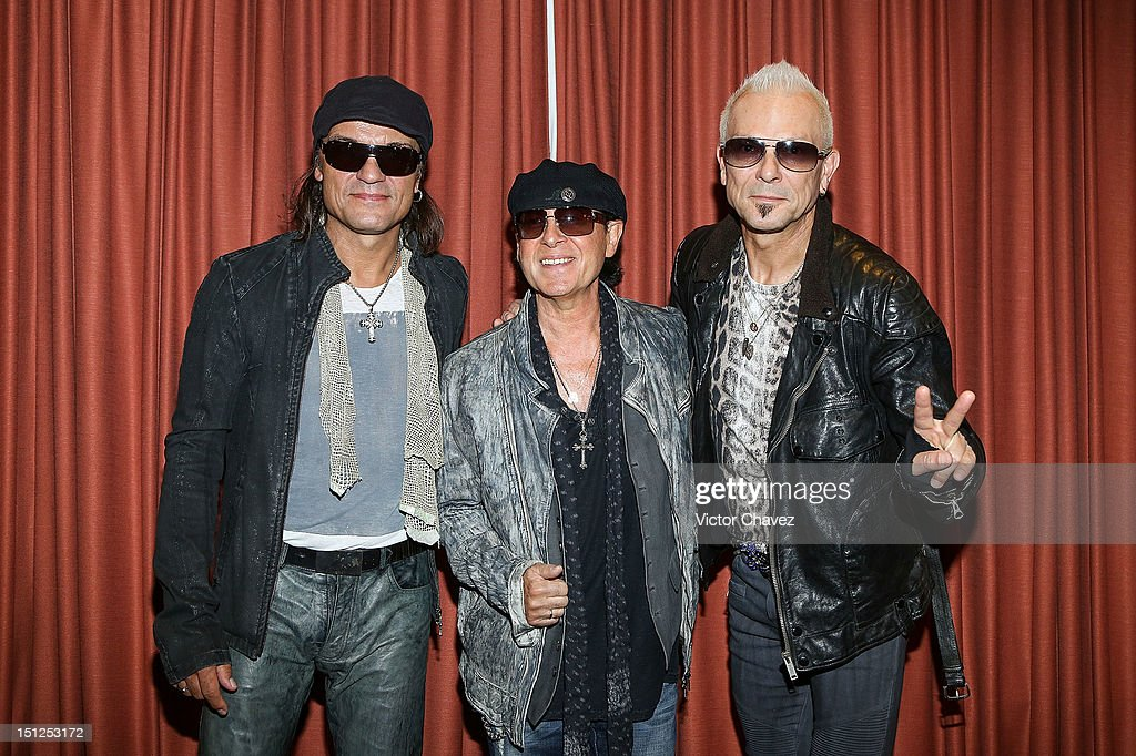Musician Matthias Jabs, Klaus Meine and Rudolf Schenker members of the rock band Scorpions pose to photographers before their press conference at Hotel Nikko Polanco on September 4, 2012 in Mexico City, Mexico. Scorpions will be performing a concert at Arena Ciudad De Mexico.