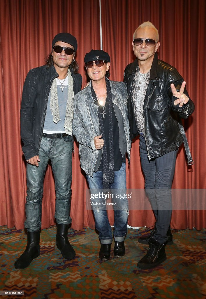 Musician <a gi-track='captionPersonalityLinkClicked' href=/galleries/search?phrase=Matthias+Jabs&family=editorial&specificpeople=710280 ng-click='$event.stopPropagation()'>Matthias Jabs</a>, <a gi-track='captionPersonalityLinkClicked' href=/galleries/search?phrase=Klaus+Meine&family=editorial&specificpeople=240345 ng-click='$event.stopPropagation()'>Klaus Meine</a> and <a gi-track='captionPersonalityLinkClicked' href=/galleries/search?phrase=Rudolf+Schenker&family=editorial&specificpeople=710263 ng-click='$event.stopPropagation()'>Rudolf Schenker</a> members of the rock band Scorpions pose to photographers before their press conference at Hotel Nikko Polanco on September 4, 2012 in Mexico City, Mexico. Scorpions will be performing a concert at Arena Ciudad De Mexico.