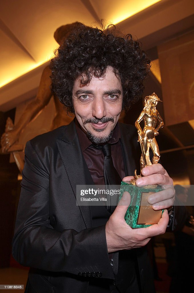Musician Max Gazze shows his award for the Best Song at the end of 2011 Premi David di Donatello Italian Academy Awards at Auditorium della Conciliazione on May 6, 2011 in Rome, Italy.
