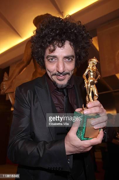 Musician Max Gazze shows his award for the Best Song at the end of 2011 Premi David di Donatello Italian Academy Awards at Auditorium della...