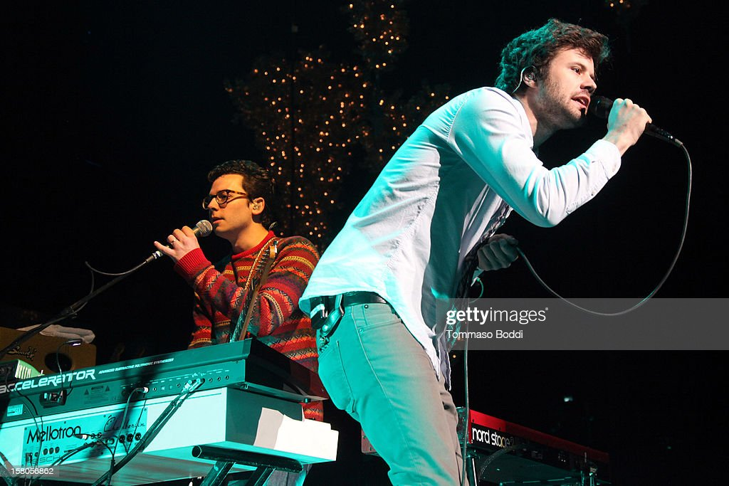 Musician Michael Angelakos and Nate Donmoyer of Passion Pit perform at the KROQ's Acoustic Christmas held at the Gibson Amphitheatre on December 9, 2012 in Universal City, California.