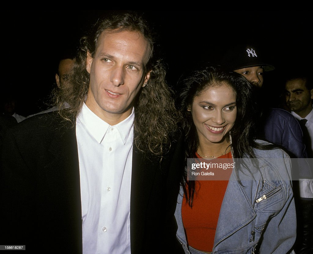 Musician <a gi-track='captionPersonalityLinkClicked' href=/galleries/search?phrase=Michael+Bolton&family=editorial&specificpeople=208230 ng-click='$event.stopPropagation()'>Michael Bolton</a> and singer Vanity attend Virgin Records Party on February 23, 1990 at Pazzia Restaurant in Los Angeles, California.