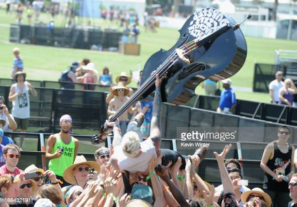 Musician Michael Camino of the band Skinny Lister performs while crowd surfing during day 1 of the 2013 Coachella Valley Music Arts Festival at the...